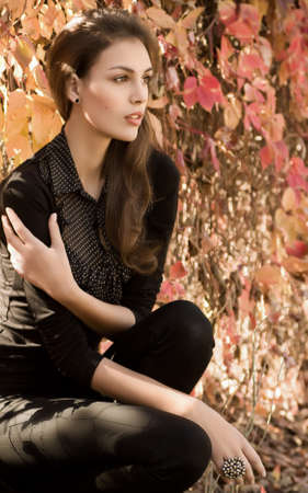 Beautiful girl in autumn garden Stock Photo - 30548820