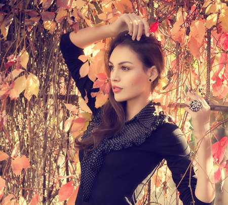 Beautiful girl in autumn garden Stock Photo - 30548824