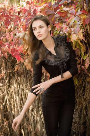 Beautiful girl in autumn garden Stock Photo - 30548830