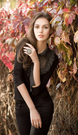 Beautiful girl in autumn garden Stock Photo - 30548831