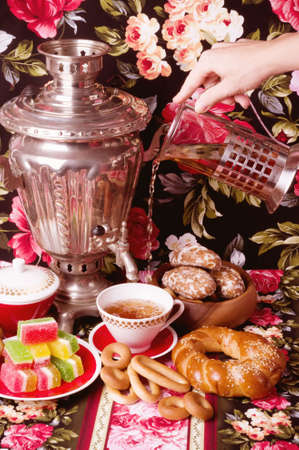 Samovar, a traditional old Russian tea kettle with bagels and marmalades photo