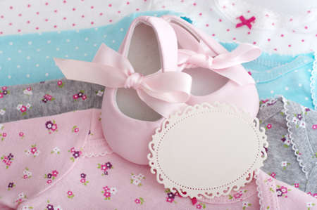fashion  babies's wear: Baby girl colorful clothes with baby boots with card Stock Photo