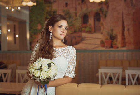 green yellow: Beautiful bride with stylish make-up in white dress