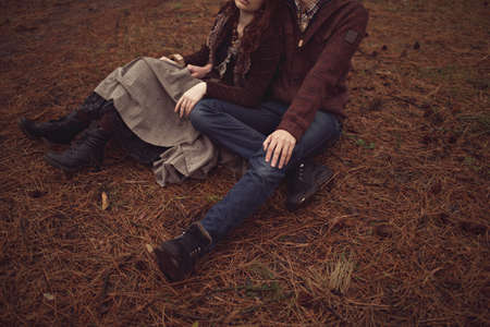 Young couple laying on park lawn photo