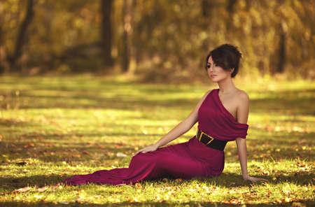 autumn garden: Beautiful girl in autumn garden