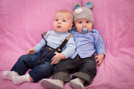 Two little baby boys photo