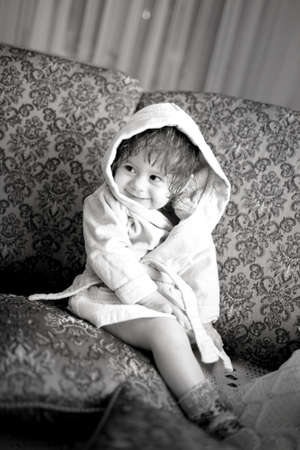 Baby girl in a plush bathrobe photo