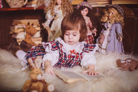 admitted: Cute charming little lady with dolls. Retro style.