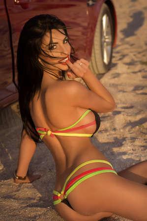 cute car: Sexy bikini girl posing at beach