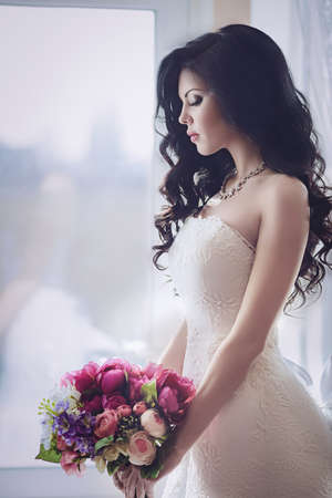 closeup: Beautiful bride with stylish make-up in white dress