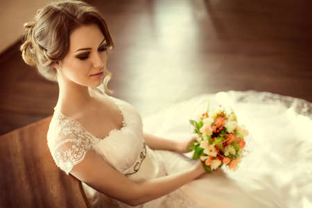 winter wedding: Beautiful bride with stylish make-up in white dress