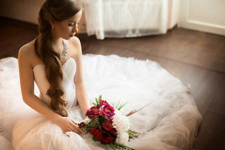 white dresses: Beautiful bride with stylish make-up in white dress