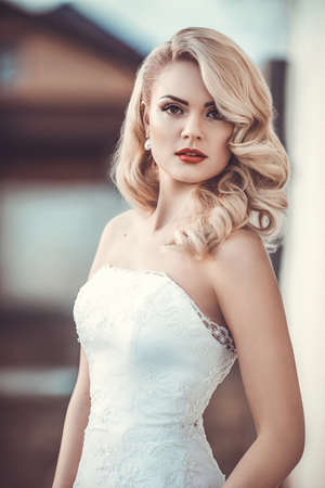 bride: Beautiful bride with stylish make-up in white dress