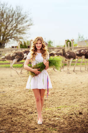 Beautiful Girl and Ostrich in the protected park Stock Photo