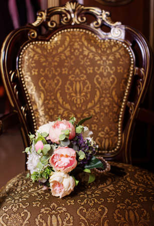 antique chair: Beautiful wedding bouquet on an antique chair Stock Photo