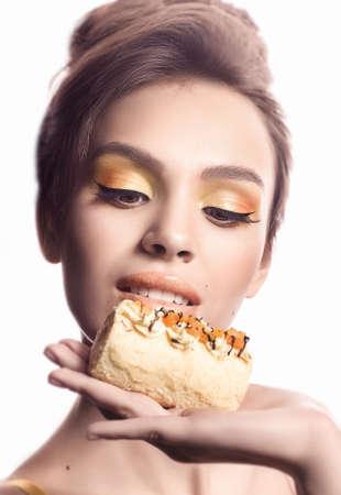 praline: Beautiful fashion girl with delicious orange praline