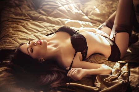 sexy woman on bed: Sexy beautiful brunette girl in underclothes