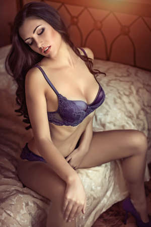 bed clothes: Sexy beautiful brunette girl in underclothes