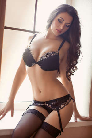 sexy pose: Sexy beautiful brunette girl in underclothes