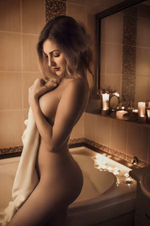 nude nature: Young beautiful sexy woman in the bathroom