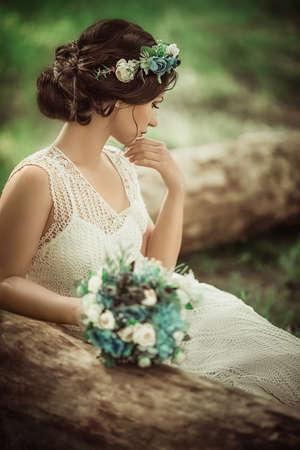 Beautiful bride in white dress in the garden photo