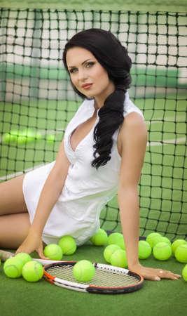 Beautiful woman playing tennis photo