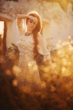 Beautiful bohemian girl in spring garden