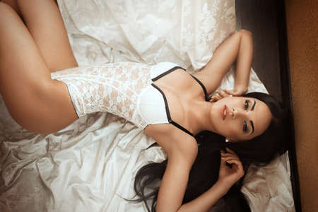 underclothes: Sexy beautiful brunette girl in white underclothes