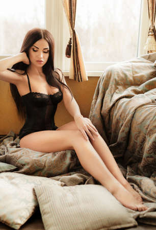underclothes: Sexy beautiful brunette girl in black underclothes Stock Photo