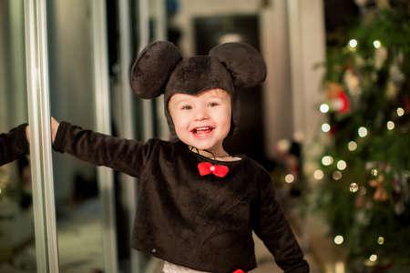 baby near christmas tree: Baby boy in carnival costume near Christmas tree