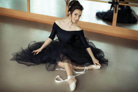 animal tutu: young ballerina is relaxing in class room
