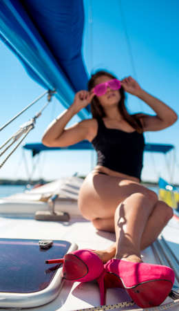 Young sexy woman on her private yacht Banque d'images