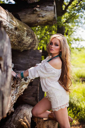 Beautiful young blonde woman in spring garden