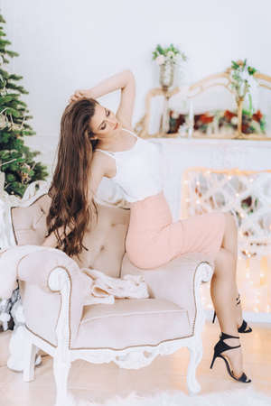 Happy young girl in Christmas decorations