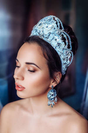 Beautiful woman model with professional makeup, in jewelry. Silver crown Banco de Imagens