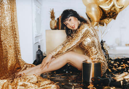 Happy Glamor Woman on a golden party. Party people