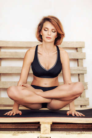 Portrait of a young woman doing yoga exercise