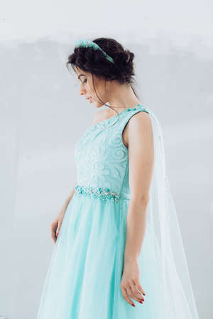 Portrait of beautiful young woman with makeup in blue wedding clothes Stock Photo
