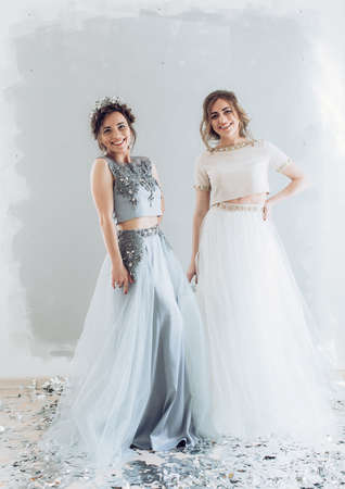 Portrait of beautiful young women with makeup in fashion clothes long dress