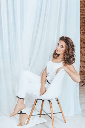 Portrait of beautiful woman with makeup in white fashion clothes