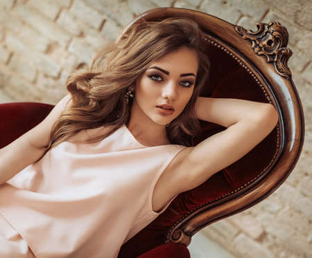 Portrait of beautiful young woman with makeup in fashion clothes 스톡 콘텐츠