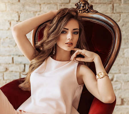 Portrait of beautiful young woman with makeup in fashion clothes Banque d'images
