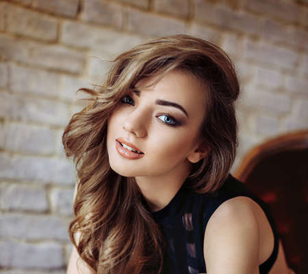 Portrait of beautiful young woman with makeup in fashion clothes Stock Photo