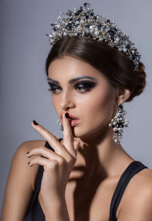 Beautiful woman model with professional makeup, in jewelry. crown Stock Photo