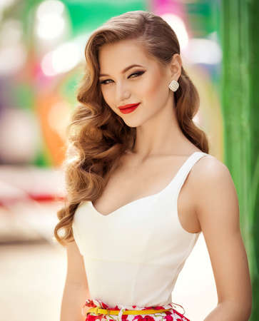 Beautiful fashion model Woman with hair, Red lipstick. Portrait of glamour girl with bright makeup. Beauty female face close up with perfect make up