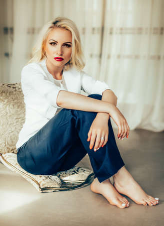 Beautiful fashion model Woman with blonde hair, Red lipstick .