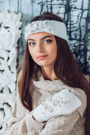 Portrait of beautiful young brunette woman with makeup in hat Stock Photo