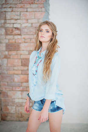 Portrait of a beautiful girl with makeup in blue fashion clothes Stock Photo