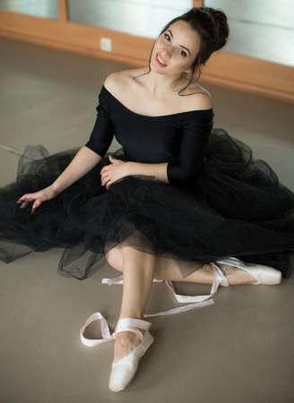 young ballerina is relaxing in class room