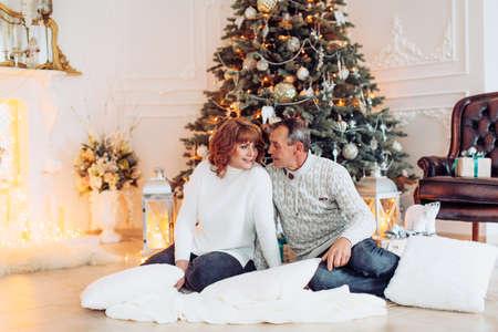 Beautiful family waiting for Christmas Stock Photo